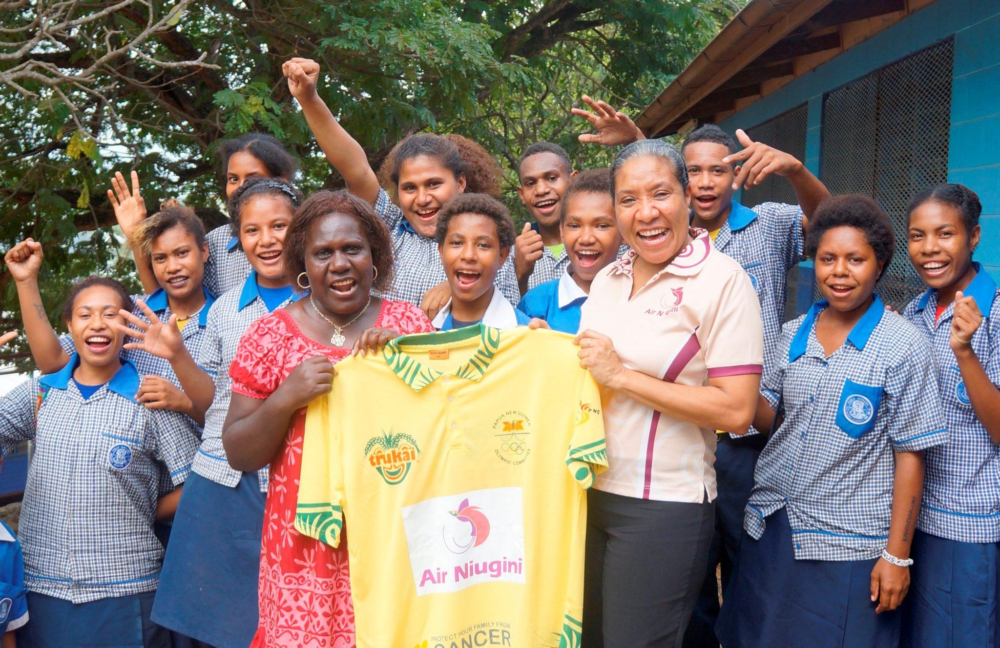 Air Niugini presents Fun Run shirts to schools